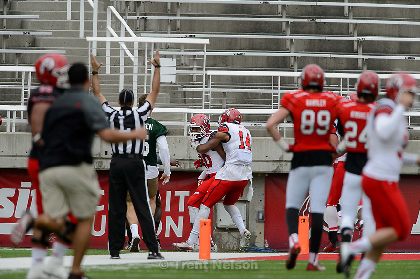Trent Nelson     The Salt Lake Tribune<br /> Marcus Williams and Brian Allen celebrate Williams's game ending touchdown interception at the Utah Football Red &amp; White game in Salt Lake City, Saturday April 25, 2015.