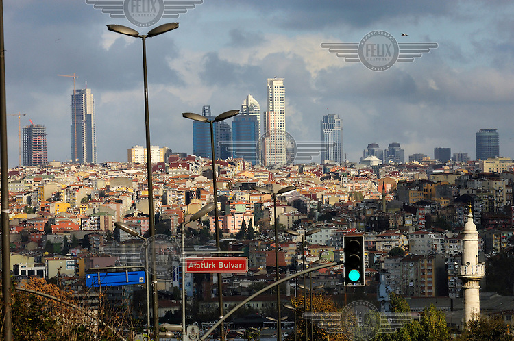 Highrise towers springing up on the fringes of the city with the minaret of an old mosque close to the Golden Horn in the foreground.