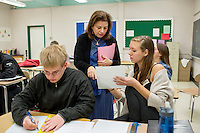 Sandra Haupt works with Senior students in her Intro to Calc class at Concord-Carlisle Regional High School in Concord, MA, USA. The class has partnered with MIT Blossoms to use video education tools in conjunction with regular lessons to reinforce key concepts.