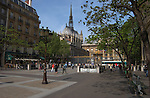 The paris law courts, Palaise de Justice, with the spire of the Cathedral of Notre-Dame in the background. Paris, France