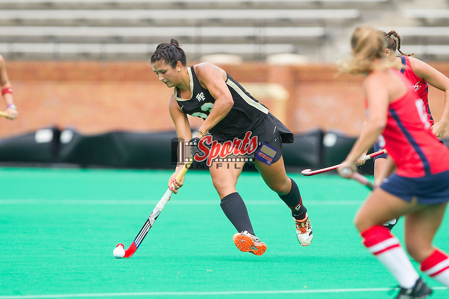 Anna Kozniuk (22) of the Wake Forest Demon Deacons controls the ball during first half action against the Richmond Spiders at Kentner Stadium on September 29, 2013 in Winston-Salem, North Carolina.  The Demon Deacons defeated the Spiders 1-0 in overtime.  (Brian Westerholt/Sports On Film)