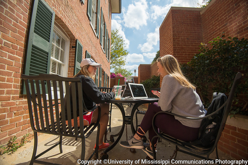 Freshmen Gini James, left, and Alyssa Hepperich find an out of the way spot to wait for class and study. Photo by Kevin Bain/University Communications Photography