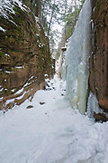 Flume Gorge in Lincoln, New Hampshire during the winter season. Located in Franconia Notch, Flume Brook travels through this gorge.