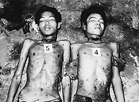 Prisoners executed by the Khmer Rouge at their S-21 detention centre at Tuol Sleng, where over 16,000 inmates were killed between 1975 and 1979. The photograph was taken by the Khmer.