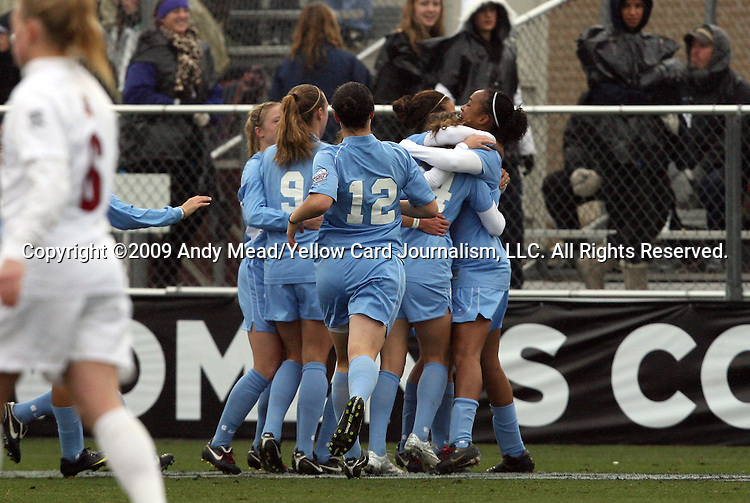 06 December 2009: North Carolina's Jessica McDonald (right) celebrates her first half goal with teammates. The Stanford University Cardinal played the University of North Carolina Tar Heels at Aggie Soccer Stadium in College Station, Texas in the NCAA Division I Women's College Cup Championship game.