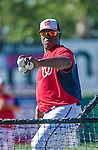 16 March 2014: Washington Nationals coach Nilson Robledo tosses batting practice prior to a Spring Training Game against the Detroit Tigers at Space Coast Stadium in Viera, Florida. The Tigers edged out the Nationals 2-1 in Grapefruit League play. Mandatory Credit: Ed Wolfstein Photo *** RAW (NEF) Image File Available ***