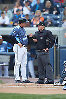 West Michigan Whitecaps manager Lance Parrish (13) discusses a call with home plate umpire Lance Seilhamer during the game against the South Bend Cubs at Fifth Third Ballpark on June 10, 2018 in Comstock Park, Michigan. The Cubs defeated the Whitecaps 5-4.  (Brian Westerholt/Four Seam Images)