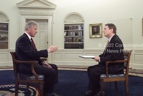 United States President Bill Clinton responds to a question from Jim Lehrer during a taping of the Lehrer News Hour in the Oval Office at the White House in Washington, D.C. on January 26, 2000, on the eve of Clinton's last State Of The Union Address.                                                                Mandatory Credit: William Vasta / White House via CNP