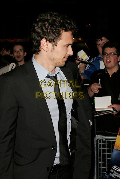 "JAMES FRANCO.Arrivals at the ""Spider-Man 3"" afterparty held at The Freemasons' Hall, Holborn, London, England..April 23rd, 2007.spiderman spider man half length black suit jacket stubble facial hair profile .CAP/AH.©Adam Houghton/Capital Pictures"