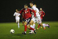 Vardan Bakalyan runs away from Ferid Matri in the Armenia v Switzerland UEFA European Under-19 Championship Qualifying Round match at New Douglas Park, Hamilton on 11.10.12.