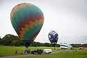 07/06/16<br /> <br /> After weeks of rain the Nottingham and Derby Hot Air Balloon Club finally get to launch their three hot air balloons from Allestree Park, Derby.
