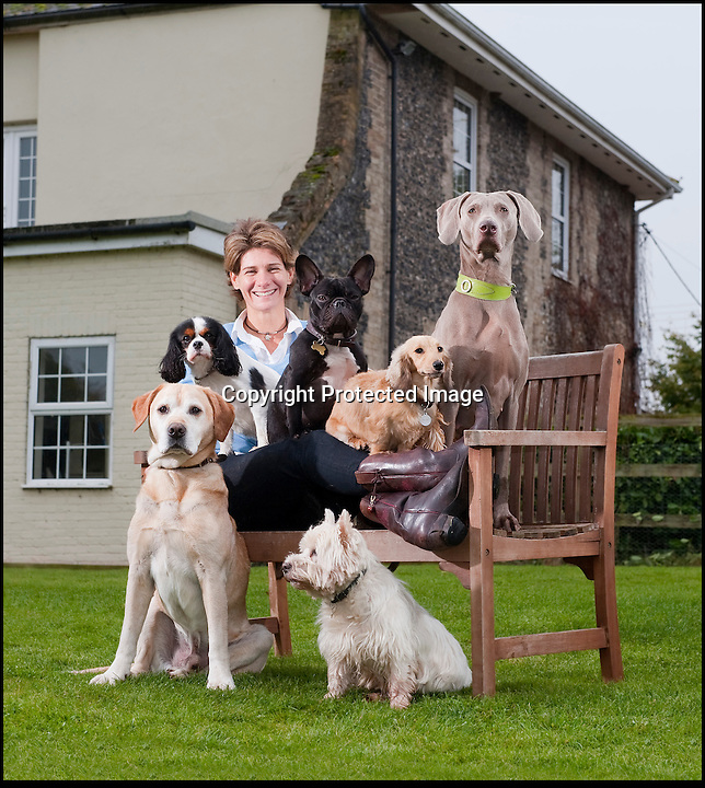 BNPS.co.uk (01202 558833).Pic: Phil Yeomans/BNPS..Upmarket hotel for posh dogs.....Sarah Mountford of House of Mutt - Britains first 'five star' hotel for hounds - set up to offer luxury accomodation for Britains top dogs in the heart of rural Suffolk...Sarah offers a luxury retreat for some of Britain's most pampered pooches where the highly strung pets can relax and unwind from the stresses of urban life and demanding owners...With no kennels or cages Sarah's pamperred pooches get the canine answer to an up-market Spa resort with long walks, stress checks, warm fires, comfy couches, medical onceover's, shampoos and they can even have their portrait painted..before being delivered back to the door of their grateful owner's..Sarah is struggling to kep up ith demand for her new venture based in Fakenham magna...with many owners asking if they can book in as well.