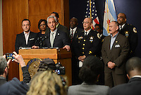 Chicago Mayor Rahm Emanuel during a press conference at Chicago City Hall flanked by Interim Chicago Police Superintendent John Escalante (second from right, front row) announcing more Tasers for Chicago police officers and training following a deadly shooting involving Chicago police over the weekend while Mayor Emanuel was on vacation in Cuba in Chicago, Illinois on December 30, 2015.  Over the weekend, Chicago police shot and killed 55 year old Bettie Jones and 19 year old Quintonio LeGrier while responding to a call over a domestic incident.