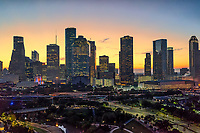 Houston skyline at sunrise with the early morning glow over the city. This Houston Cityscape show off all the city tallest skycrapers in this compact downtown view. The  Houston skyline has sone of the tallest buildings in the southern US. In this image you can see the Heritage Plaza, Chevron, Wells Fargo and the tallest building in Houston the J P Morgan Chase Tower at 1002 ft and it is the 17 tallest in the US. Houston is the seat of Harris county and was founded in 1837 near the banks of the Buffalo Bayou or Allen Landing as it is called today. The city was name after General San Houston after he won the battle of San Jacinto. Houston has been a growing city because of the port of houston and railroads along with oil boom from the early 1901. Houston has other industry that have made it thrive in america such as energy, manufacturing, aeronautics, and transportation. Also NASA mission control is located in the city. Houston has also taken the lead on health care with many people coming to the Medical Center for top notch doctors and hospital with the latest advancement in medical care.