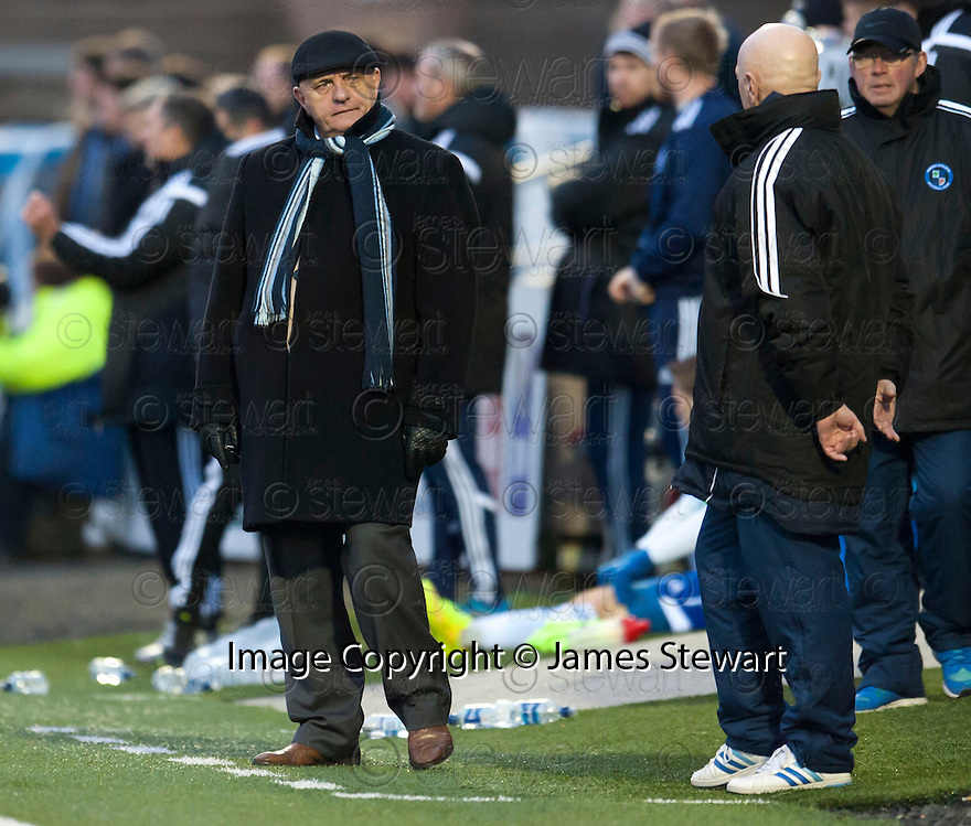 Forfar manager Dick Campbell looks back at assistant manager Ian Campbell .