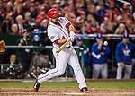 13 October 2016: Washington Nationals outfielder Chris Heisey connects for a 2-run homer in the 7th inning of Game 5 of the NLDS against the Los Angeles Dodgers at Nationals Park in Washington, DC. The Dodgers edged out the Nationals 4-3, to take Game 5, and the Series, 3 games to 2, moving on to the National League Championship against the Chicago Cubs. Mandatory Credit: Ed Wolfstein Photo *** RAW (NEF) Image File Available ***