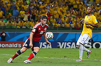 A large bug lands on the arm of James Rodriguez of Colombia