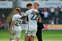 Joe Rodon is congratulated by Graham Potter Manager of Swansea City during the Sky Bet Championship match between Swansea City and Rotherham United at the Liberty Stadium in Swansea, Wales, UK.  Friday 19 April 2019