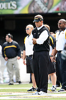 MU Head Coach Gary Pinkel watches as his team warms up before the game with the Western Michigan Broncos at Memorial Stadium in Columbia, Missouri on September 15, 2007. The Tigers won 52-24.