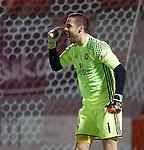 Remi Matthews celebrates his saves in the penalty shootout