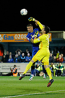 AFC Wimbledon's Cody McDonald contests the high ball with Milton Keynes' Lee Nicholls during the Sky Bet League 1 match between AFC Wimbledon and MK Dons at the Cherry Red Records Stadium, Kingston, England on 22 September 2017. Photo by Carlton Myrie / PRiME Media Images.