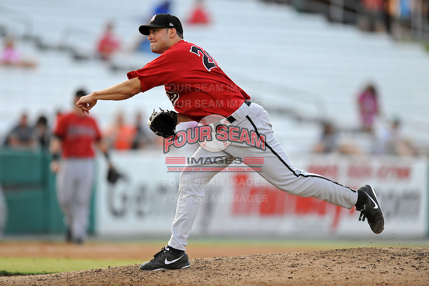 Birmingham Barons starting pitcher Spencer Arroyo #20 delivers a pitch during game three of the Southern League Northern Division Championship Series against the Tennessee Smokies at Smokies Park on Septmeber 7, 2013 in Kodak, Tennessee. The Smokies won the game 9-2. (Tony Farlow/Four Seam Images)