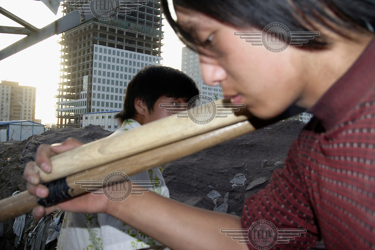 Migrant workers involved in the costruction of the Beijing Olympic Games Village.