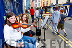 Maeve McCarthy and Lilly O'Shea Cromane busking at Kfest in Killorglin on Sunday