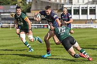 Jason Harries of London Scottish is tackled by George Worth of Nottingham Rugby (right) during the Greene King IPA Championship match between London Scottish Football Club and Nottingham Rugby at Richmond Athletic Ground, Richmond, United Kingdom on 15 April 2017. Photo by David Horn.