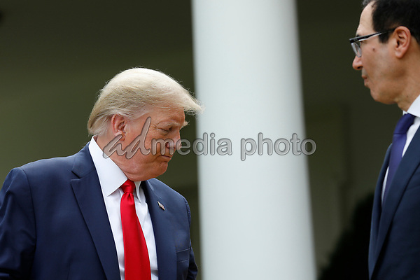 United States President Donald J. Trump departs after delivering remarks on China in the Rose Garden at the White House in Washington, DC on May 29, 2020. At right is US Secretary of the Treasury Steven T. Mnuchin<br /> Credit: Yuri Gripas / Pool via CNP/AdMedia