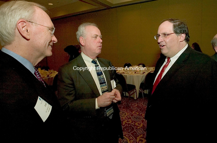 WATERBURY, CT-17 MARCH 2008 --031808JS05-Waterbury Mayor Michael J. Jarjura, right, talks with Waterbury Hospital President and CEO John Tobin, center and Fred L. Luedke of Neoperl, Inc., left, following his State of the City address in front of the Waterbury Regional Chamber Tuesday at the Holiday Inn Hotel in Waterbury. <br /> Jim Shannon / Republican-American