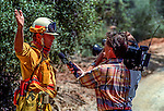 August 17, 1992 Angels Camp, California -- Old Gulch Fire—Murphys Fire Chief Tony Bacon talks to television crew in Fricot City.  The Old Gulch Fire raged over some 18,000 acres, destroying 42 homes while threatening the Mother Lode communities of Murphys, Sheep Ranch, Avery and Forest Meadows.
