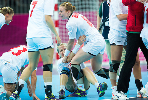11 AUG 2012 - LONDON, GBR - Heidi Løke (NOR) (seated centre) and Karoline Dyhre Breivang (NOR) (standing centre) of Norway celebrate winning the women's London 2012 Olympic Games handball final against Montenegro at the Basketball Arena in the Olympic Park, in Stratford, London, Great Britain .(PHOTO (C) 2012 NIGEL FARROW)