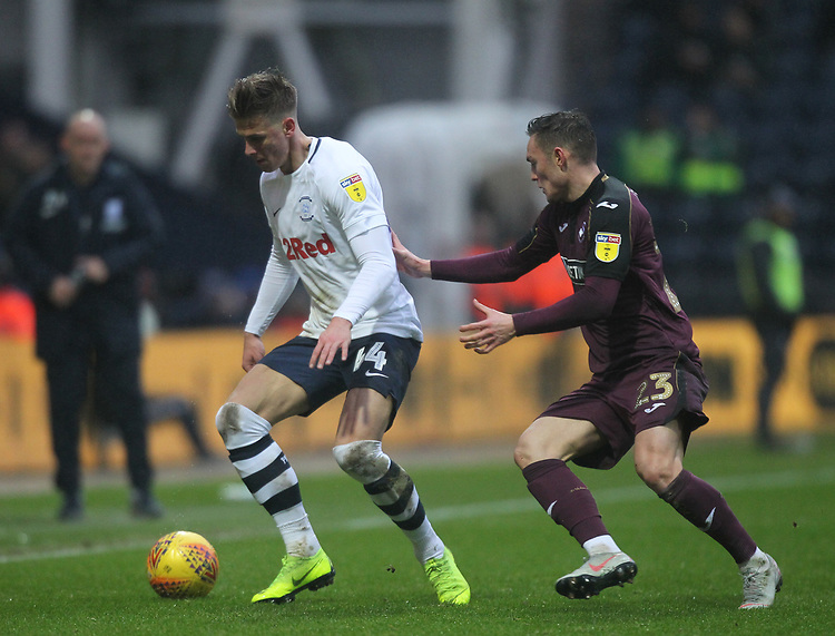 Preston North End's Brad Potts battles with  Swansea City's Gylfi Sigurosson<br /> <br /> Photographer Mick Walker/CameraSport<br /> <br /> The EFL Sky Bet Championship - Preston North End v Swansea City - Saturday 12th January 2019 - Deepdale Stadium - Preston<br /> <br /> World Copyright © 2019 CameraSport. All rights reserved. 43 Linden Ave. Countesthorpe. Leicester. England. LE8 5PG - Tel: +44 (0) 116 277 4147 - admin@camerasport.com - www.camerasport.com