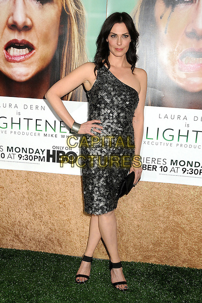 "Michelle Forbes.HBO's ""Enlightened"" Los Angeles Premiere held at Paramount Studios, Los Angeles, California, USA. .October 6th, 2011.full length black silver sequins sequined one shoulder dress clutch bag circles discs hand on hip.CAP/ADM/BP.©Byron Purvis/AdMedia/Capital Pictures."
