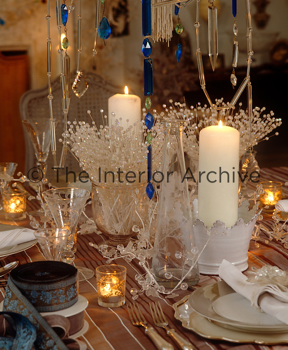 The table in the dining room is laid with tealights and frosted table decorations to add to the festive atmosphere