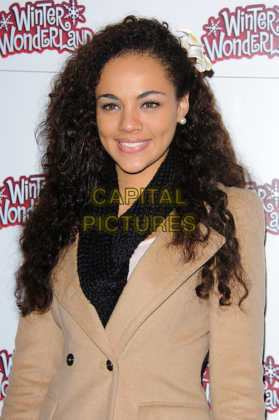 AIASHA GUSTAVE (Miss St Lucia).The Winter Wonderland in Hyde Park Corner VIP preview, London, England..November 18th, 2010.half length camel tan beige mac trenchcoat trench coat jacket black scarf.CAP/CJ.©Chris Joseph/Capital Pictures.