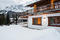 Exterior of chalet in the Italian ski resort of Cortina d'Ampezzo with the Alps in the background