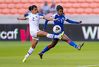 HOUSTON, TX - JANUARY 31: Gabriela Guillen #2 of Costa Rica clears the ball away from Batcheba Louis #7 of Haiti during a game between Haiti and Costa Rica at BBVA Stadium on January 31, 2020 in Houston, Texas.