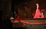 "Gabby walks in front of the judges during the formal wear segment of the Woolly Worm Princess Pageant, in Beattyville, Ky., Oct. 1, 2010.  Gabby did not say she was in the seventh grade. ""She nailed it,"" Danny said. Photo by Brandon Goodwin"