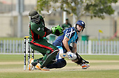 T20 World Cup Qualifying match - Scotland V Kenya at ICC Global Cricket Academy - Dubai - Scotland's Richie Berrington hits away from Kenya keeper David Obuya in the 14 run victory - Picture by Donald MacLeod  13.3.12  07702 319 738  clanmacleod@btinternet.com