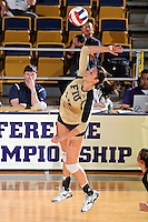 17 November 2011:  FIU middle blocker Sabrina Gonzalez (12) hits a kill shot in the second set as the FIU Golden Panthers defeated the Denver University Pioneers, 3-1 (25-21, 23-25, 25-21, 25-18), in the first round of the Sun Belt Conference Tournament at U.S Century Bank Arena in Miami, Florida.