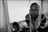 Z. A. and her daughter are seen in their room at Ktziot prison, August 21, 2007.Sudanese refugees who crossed into Israel illegally are seen in Ktiziot Prison in the Negev Dessert in Israel. About 130 women and children are living in the prison and their future is unclear. Israel said on Sunday it would turn away refugees from Sudan enforcing a policy aimed at halting illegal African migration via Egypt. Photo by Quique Kierszenbaum