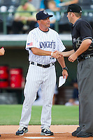 Charlotte Knights manager Joe McEwing #11 shakes hands with home plate umpire David Soucy prior to the game against the Durham Bulls at Knights Stadium on August 2, 2011 in Fort Mill, South Carolina.  The Bulls defeated the Knights 18-3.   (Brian Westerholt / Four Seam Images)