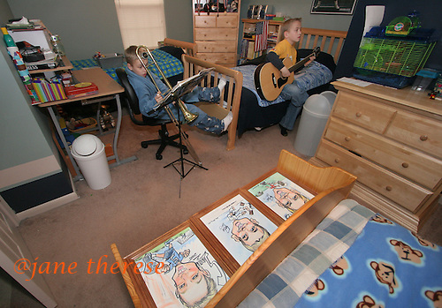 Sam Salem 12 of Telford, Pa. (left), practices the trombone on a cold Thursday March 2, 2006, while his twin brother Jake (right) practices his guitar before his lesson. The American flag hangs in the boys bedroom (behind Jake) as well as three charactures of Sam (left), Joe (center) and Jake (right), lie on the boys bench (foreground) ready to be hung. Three of the Salem children play musical instruments. Sam the trombone, Jake the guitar and Julianne the piano. The Salem children, 3 sets of twins, are from Nevel, Russia. Sophia and twin Joseph were adopted at 11 months of age by Hythem and his wife Lisa. The other twins, Selene and Julianne 13 along with Sam and Jake, were adopted just 20 months ago. All children are thriving in school, socially and physically. photo by jane therese