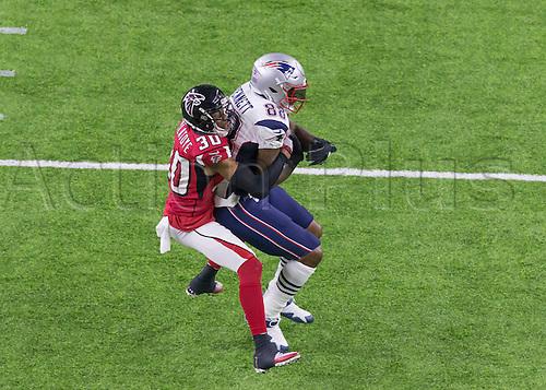 February 5th 2017, Houston, Texas, USA;   Atlanta Falcons cornerback Deji Olatoye (30) tackles New England Patriots tight end Martellus Bennett (88) during the New England Patriots 34-28 victory over the Atlanta Falcons