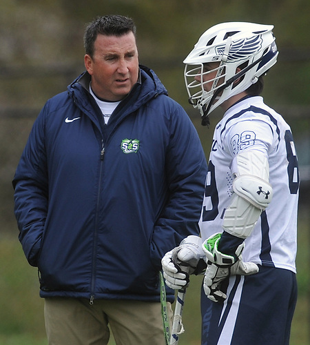 Tom Rooney, St. Dominic varsity boys lacrosse head coach, talks with his son, Tommy Rooney, before the start of a game against Long Island Lutheran at Charles Wang Athletic Complex in East Norwich on Monday, April 30, 2018.