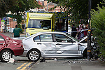 © Joel Goodman - 07973 332324 . 17/08/2013 . Manchester , UK .A suspected getaway vehicle (red Honda Accord) crashed in to a silver BMW following a knife-point robbery outside a bank on Northenden Road in Sale , Manchester yesterday afternoon (16th August 2013) . Police have arrested one man but report another is at large . Photo credit : Joel Goodman