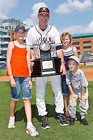 Virginia Cavaliers head coach Brian O'Connor #26 holds the ACC Championship trophy after the Cavaliers defeated the Florida State Seminoles 7-2 at the Durham Bulls Athletic Park on May 29, 2011 in Durham, North Carolina.  Photo by Brian Westerholt / Four Seam Images