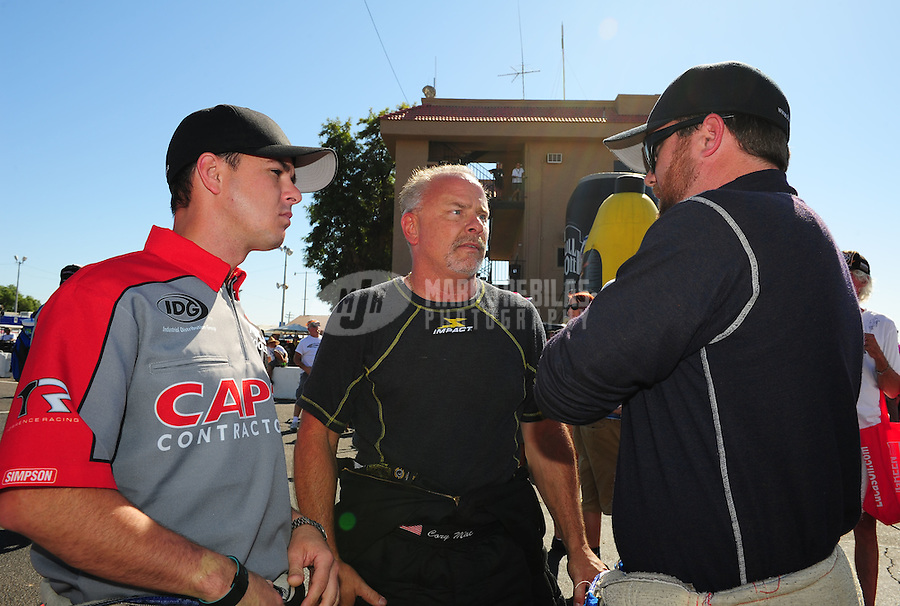Oct. 16, 2011; Chandler, AZ, USA; NHRA top fuel dragster driver Steve Torrence (left) with Cory McClenathan (center) and Shawn Langdon during the Arizona Nationals at Firebird International Raceway. Mandatory Credit: Mark J. Rebilas-